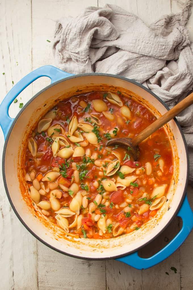 Pot of Vegan Pasta e Fagioli with Wooden Spoon