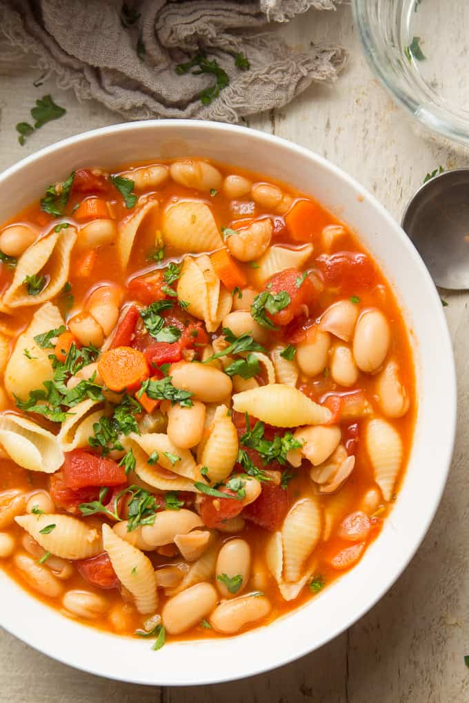 Close Up of a Bowl of Vegan Pasta e Fagioli Topped with Parsley
