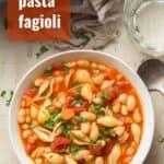 "Bowl of Vegan Pasta e Fagioli with Text Overlay Reading ""Vegan Pasta e Fagioli"""