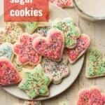 """Plate of Vegan Sugar Cookies with Glass of Almond Milk and Text Overlay Reading """"Vegan Sugar Cookies"""""""