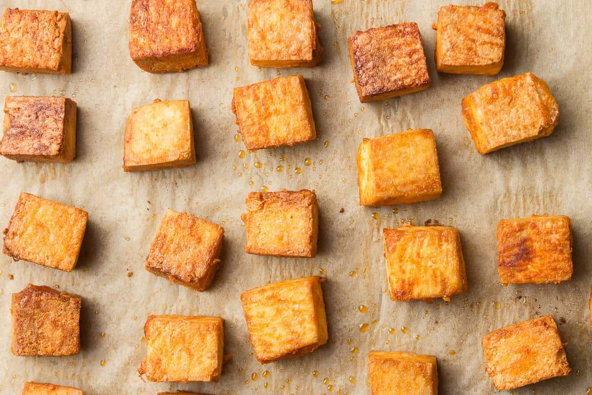 Baked Tofu Pieces on Parchment Paper