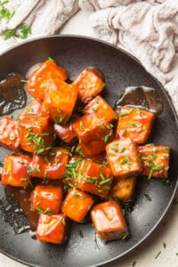 Close Up of BBQ Tofu on a Plate with Chives on Top