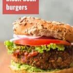 "Close Up of a Black Bean Burger with Text Overlay Reading ""Smoky Black Bean Burgers"""