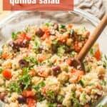 "Close Up of a Bowl of Mediterranean Quinoa Salad with Text Overlay Reading ""Mediterranean Quinoa Salad"""