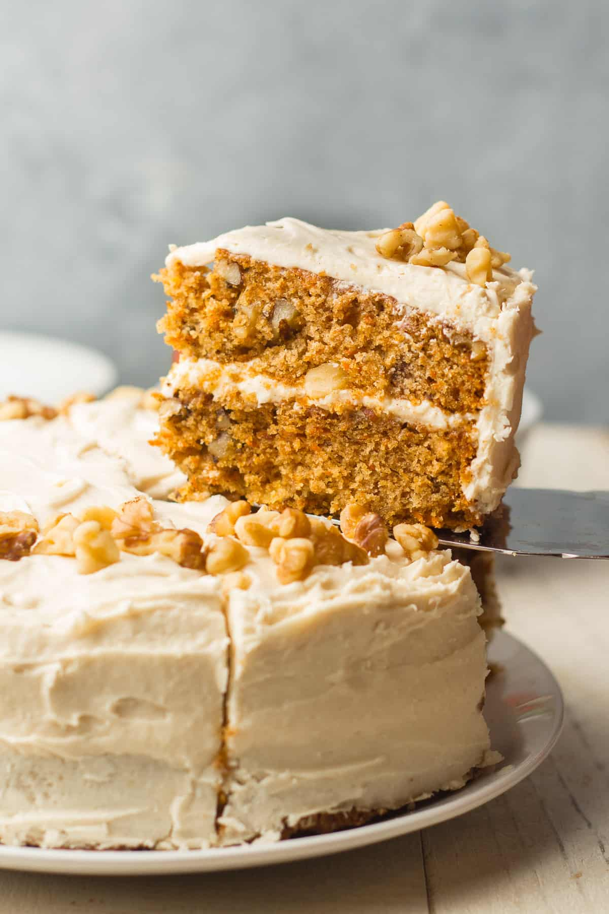 Slice of Vegan Carrot Cake Being Lifted with a Cake Server