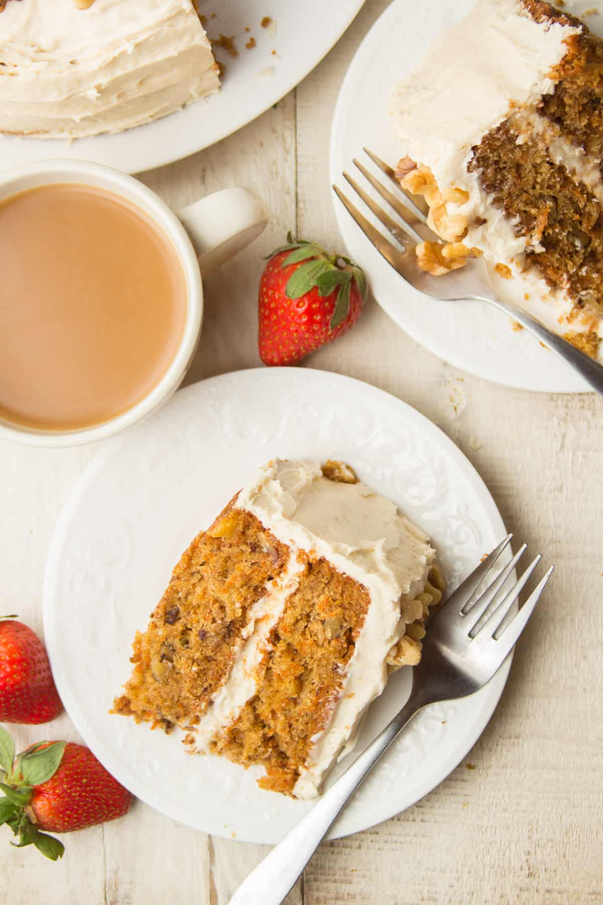 Table Set with Sliced Vegan Carrot Cake, Two Slices on Plates, and Coffee Cup