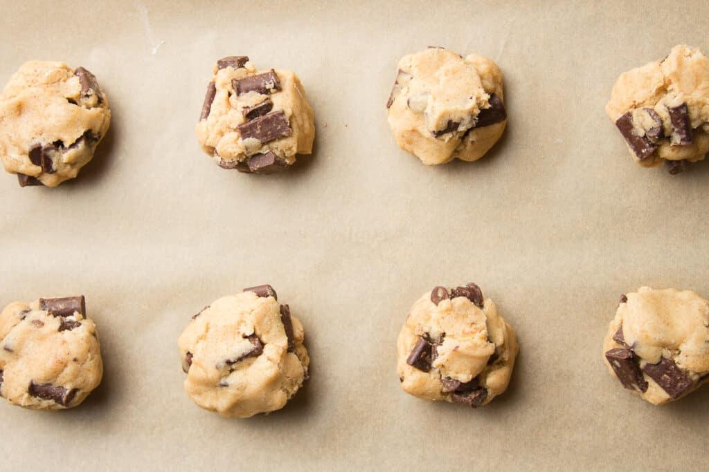Vegan Chocolate Chip Cookie Dough Balls on Parchment Paper