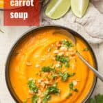 "Bowl of Carrot Soup with Text Overlay Reading ""Thai Carrot Soup"""