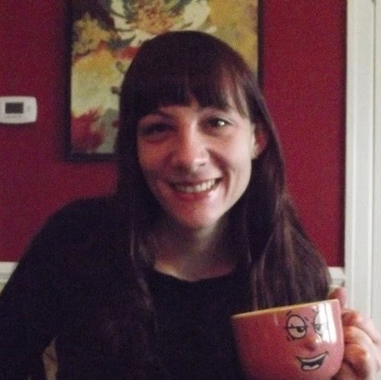 Alissa Holding a Coffee Cup