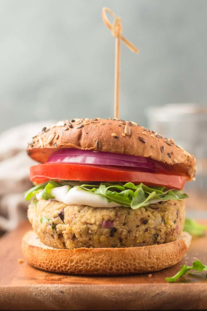 Greek Chickpea Burger with a Skewer Through It