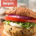 "Close Up of a Greek Chickpea Burger with Text Overlay Reading ""Greek Chickpea Burgers"""