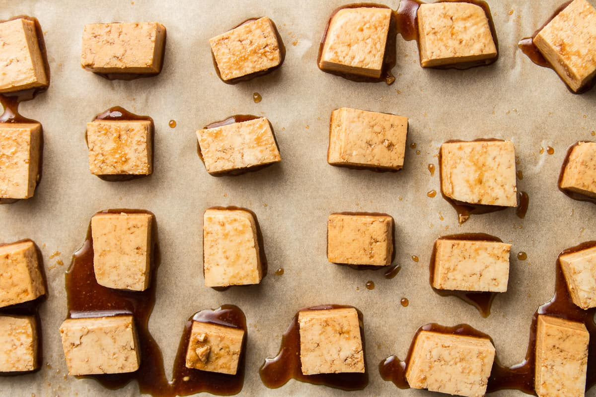 Marinated Tofu Cubes on Parchment Paper