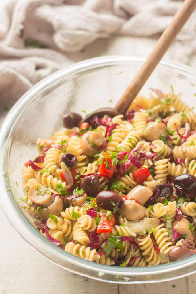 Bowl of Vegan Pasta Salad with Wooden Spoon