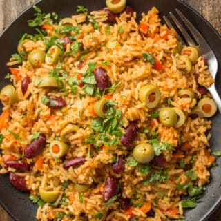 Close Up of Spanish Rice & Beans on a Black Plate