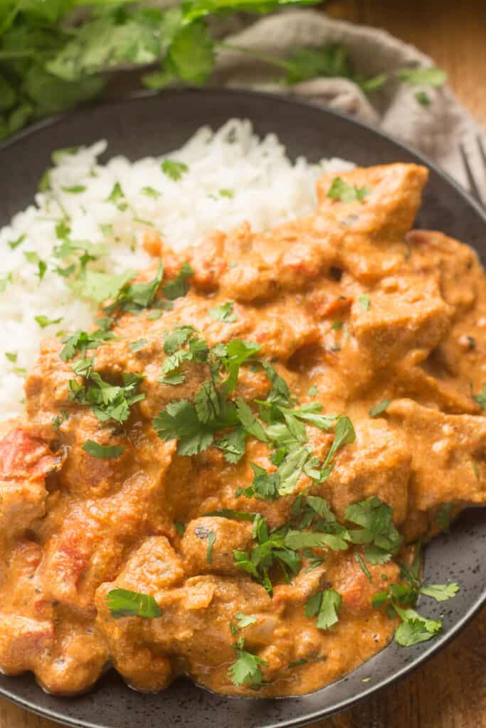 Close Up of Vegan Butter Chicken on a Plate with Rice