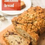"""Sliced Loaf of Vegan Zucchini Bread with Text Overlay Reading """"Vegan Zucchini Bread"""""""