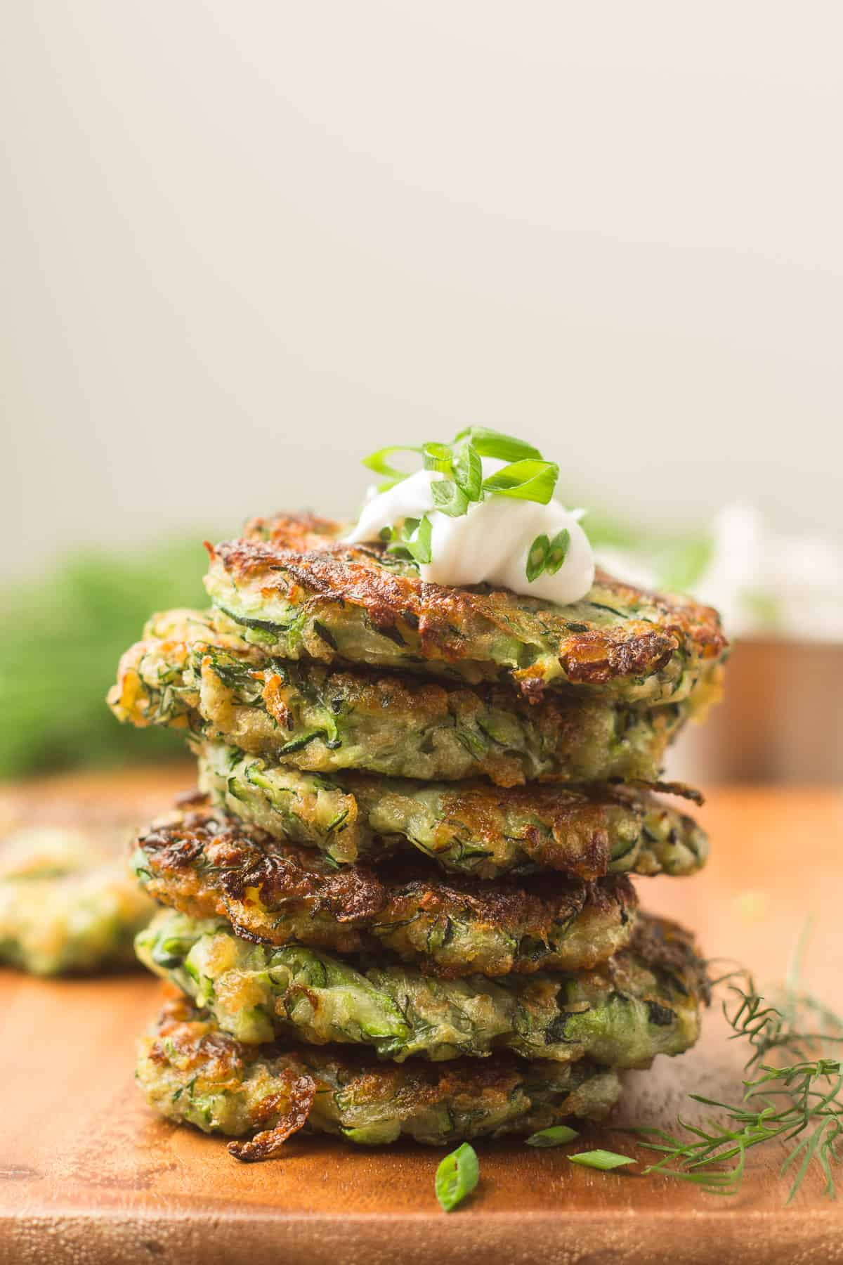 Stack of Vegan Zucchini Fritters with Cashew Cream and Chives on Top