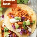 """Jackfruit Tacos on a Plate with Text Overlay Reading """"Spicy Jackfruit Tacos"""""""