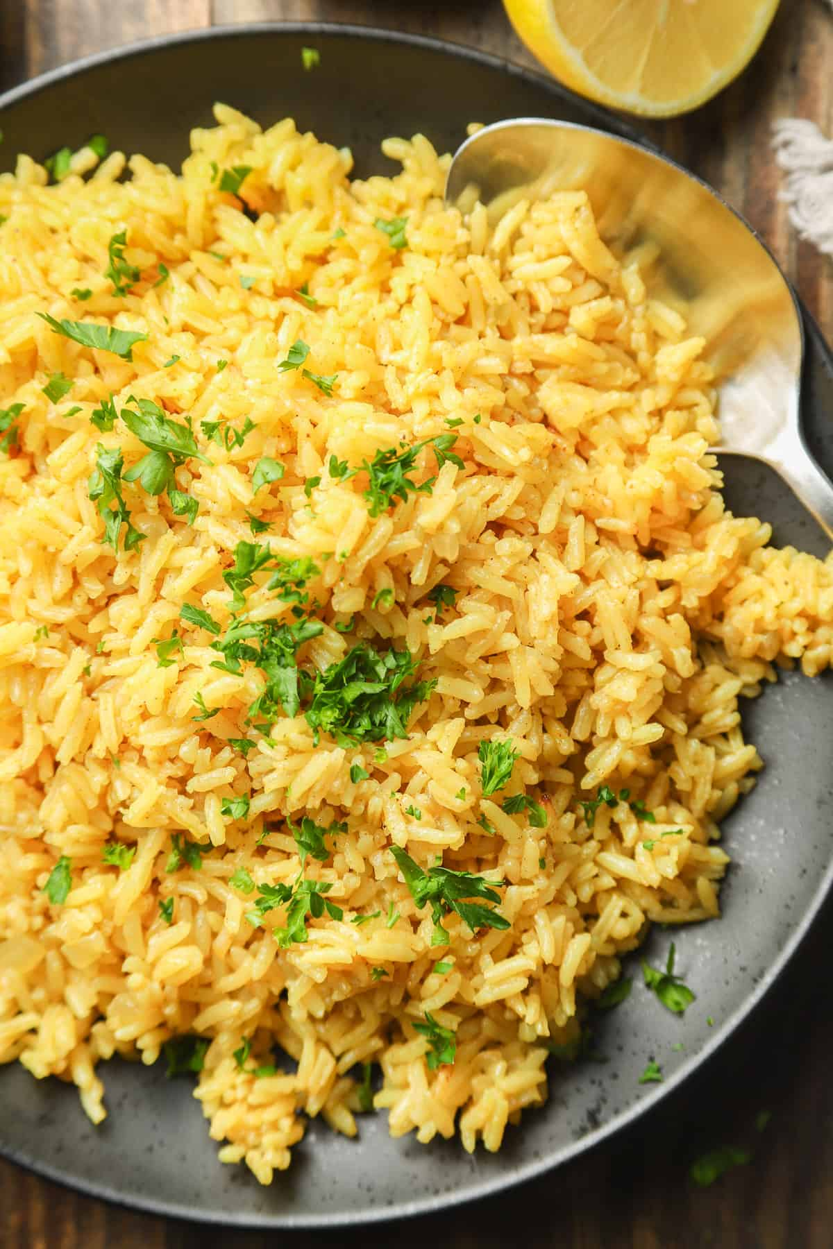 Close Up of Turmeric Rice Topped with Fresh Parsley
