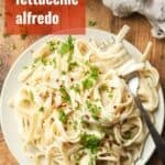 """Plate of Vegan Fettuccine Alfredo with Text Overlay Reading """"Vegan Fettuccine Alfredo"""""""