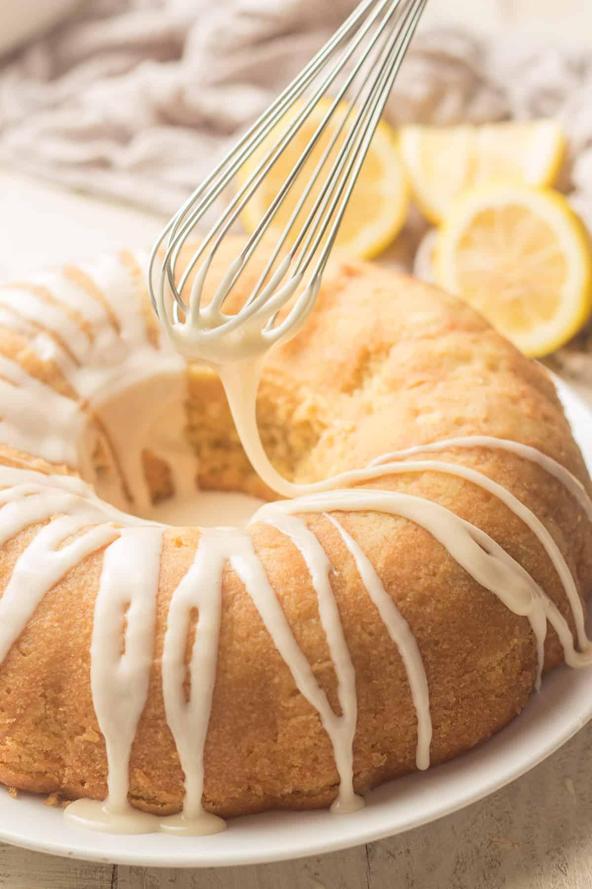 Whisk Drizzling Glaze Over a Vegan Lemon Bundt Cake