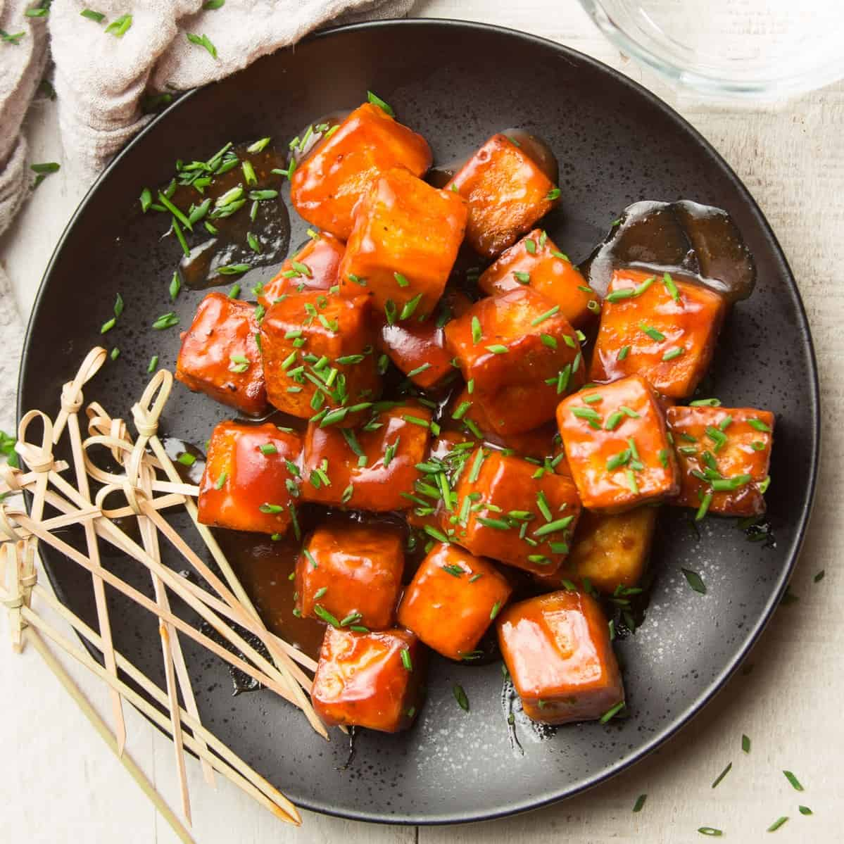 Plate of BBQ Tofu with Skewers on the Side