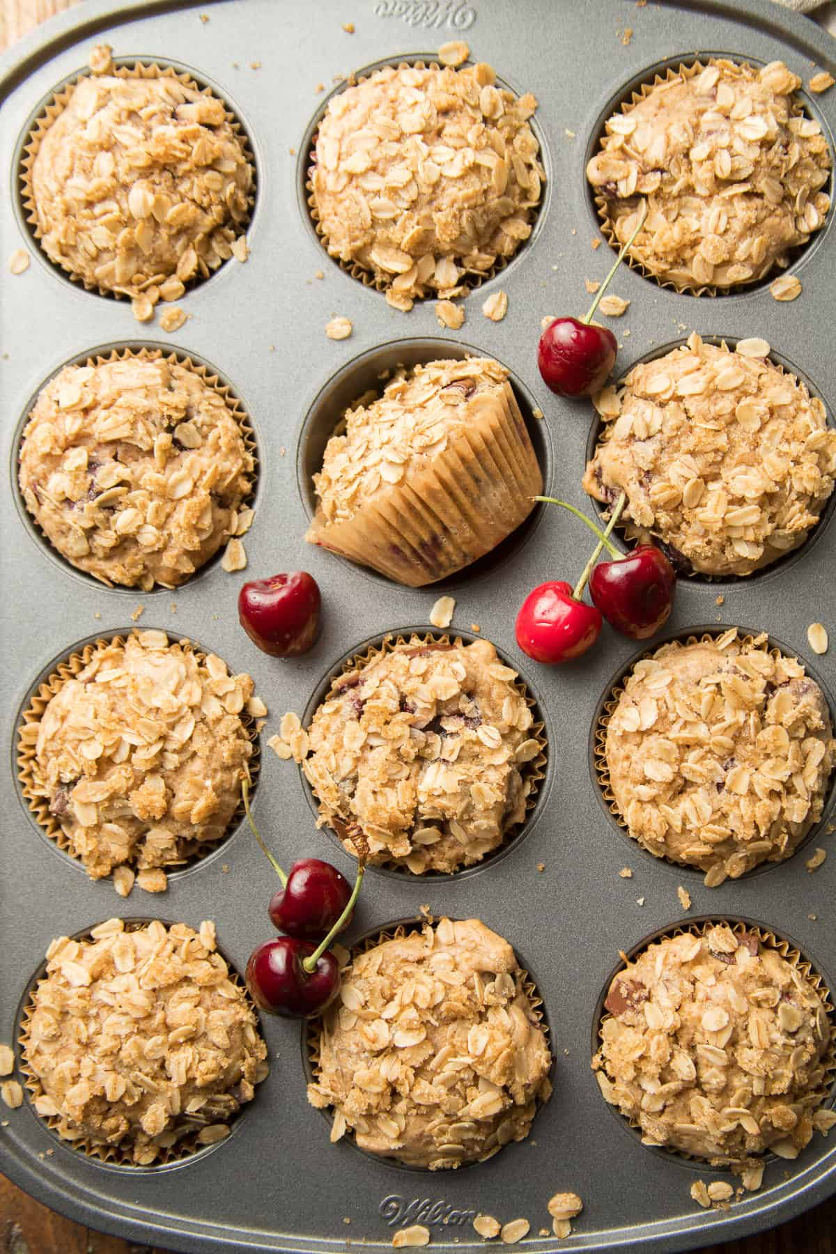 Vegan Cherry Muffins in a Tin with Fresh Cherries on Top