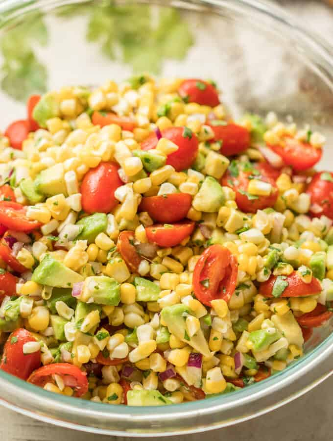 Close Up of Avocado Corn Salad in a Glass Bowl