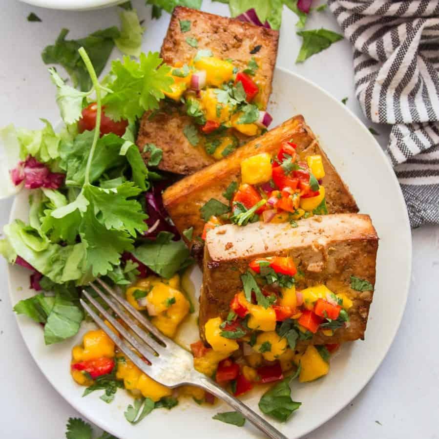 Plate of Grilled Tofu, Mango Salsa and Fresh Greens