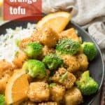 "Plate of Orange Tofu and Broccoli with Text Overlay Reading ""Crispy Orange Tofu"""