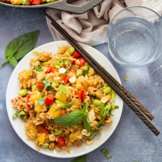 Pineapple Fried Rice on a Plate with Chopsticks