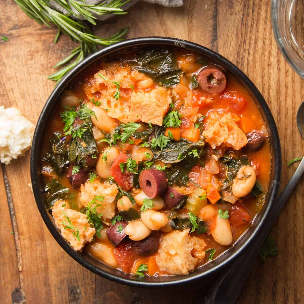 Bowl of Ribollita on a Wooden Surface