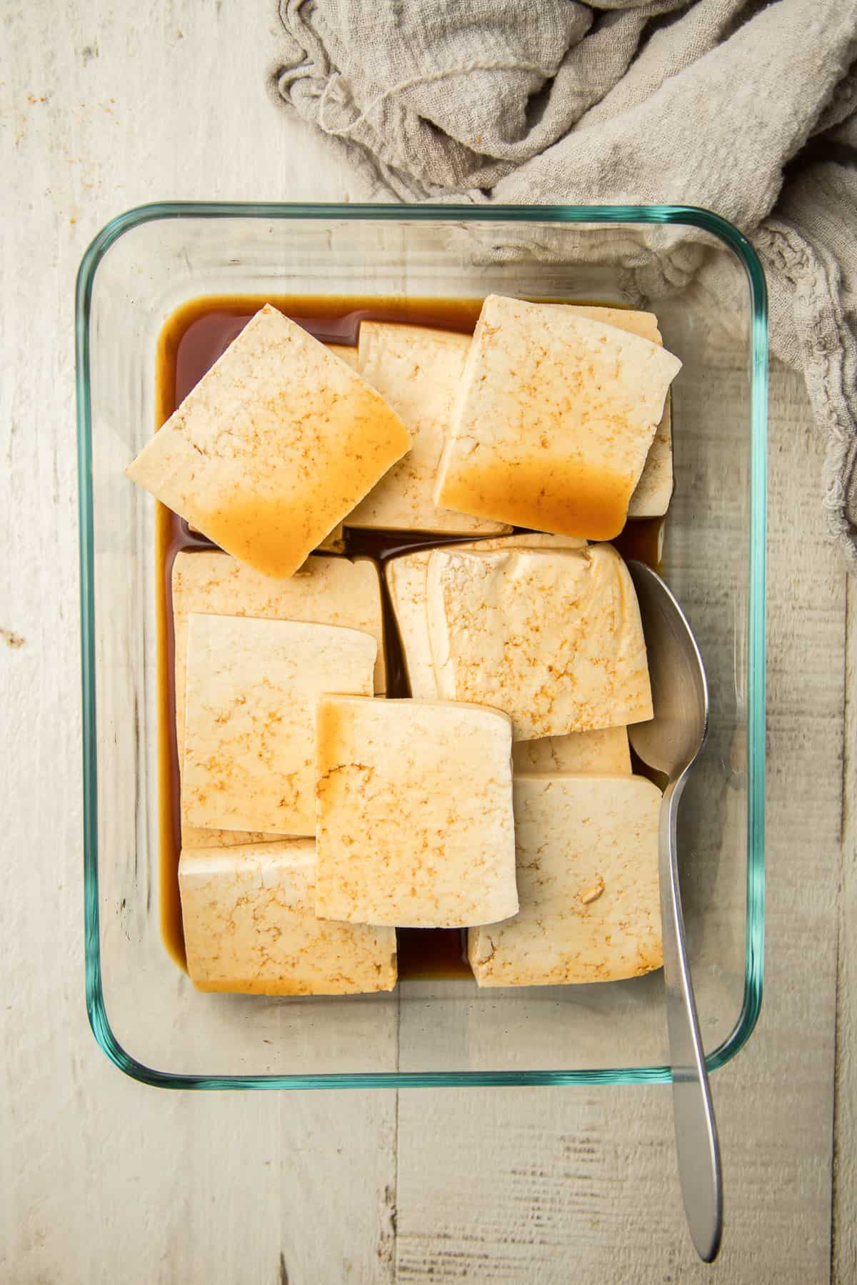 Tofu Marinating in a Glass Dish