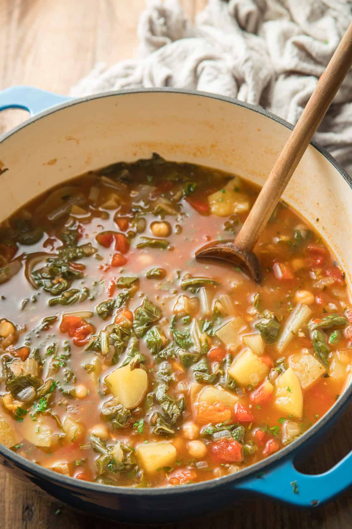 Pot of Swiss Chard Soup with Wooden Spoon