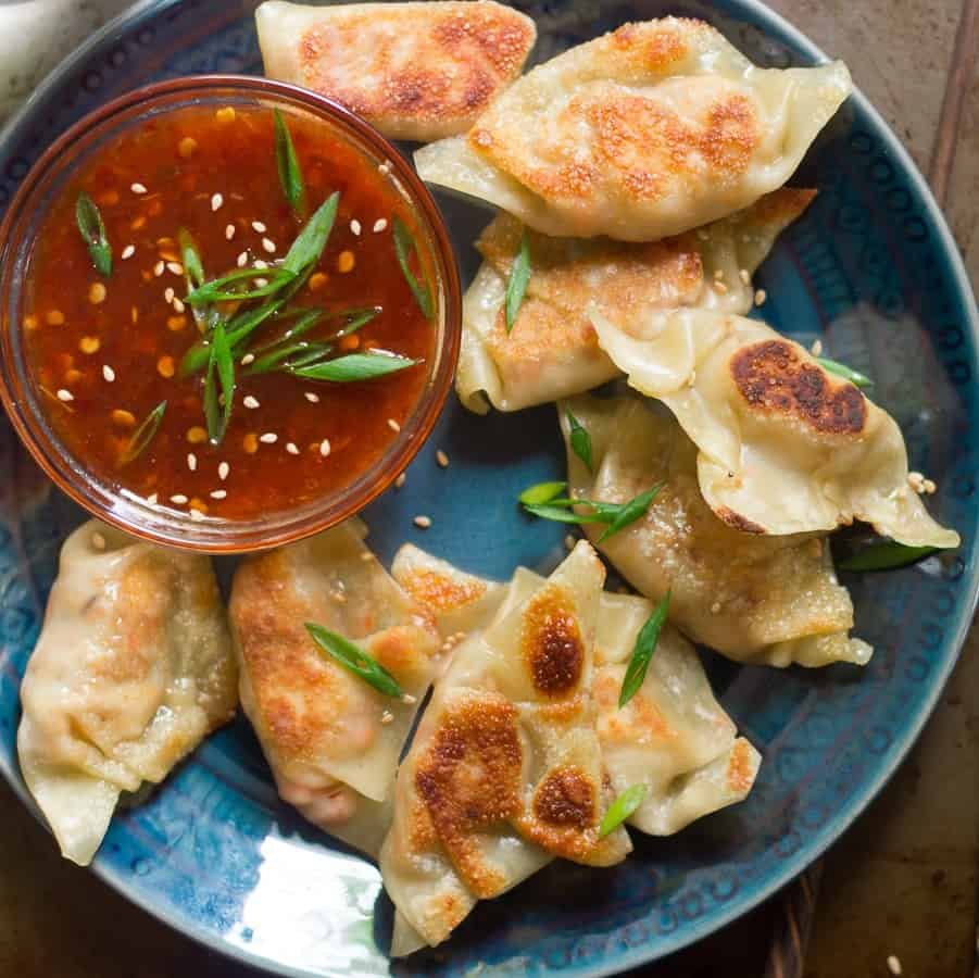Close Up of a Plate of Tofu Dumplings with Sweet Chili Dipping Sauce