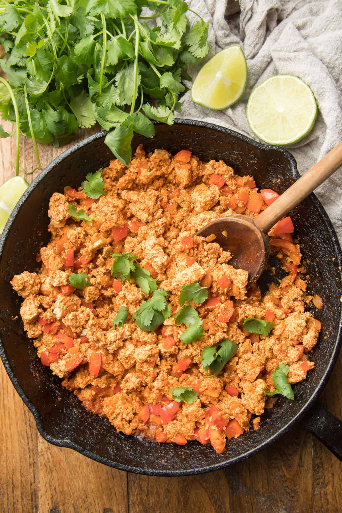 Skillet of Tofu Taco Filling with Wooden Spoon