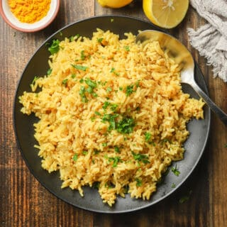 Plate of Turmeric Rice on a Wooden Surface