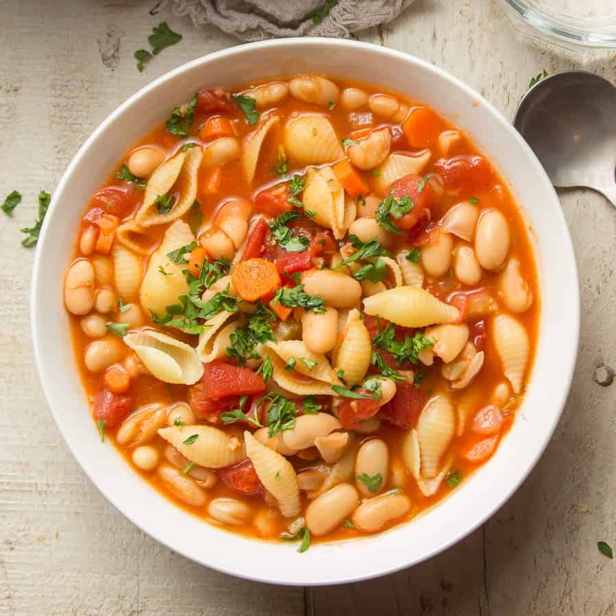 Bowl of Vegan Pasta e Fagioli with Spoon on the Side