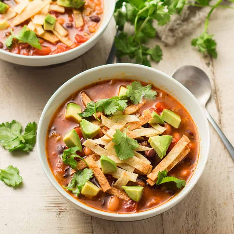 Bowl of Vegan Tortilla Soup with Spoon on the Side