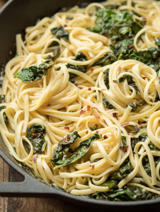 Close Up of Creamy Kale Pasta in a Skillet