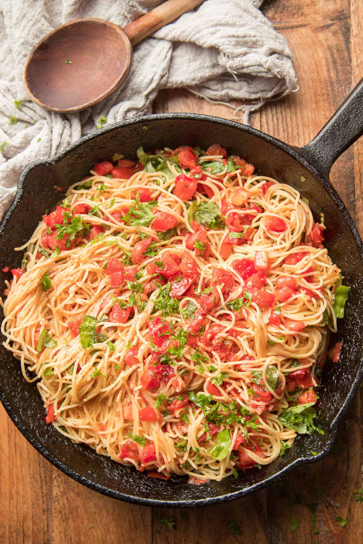 Skillet of Tomato Basil Pasta with Wooden Spoon