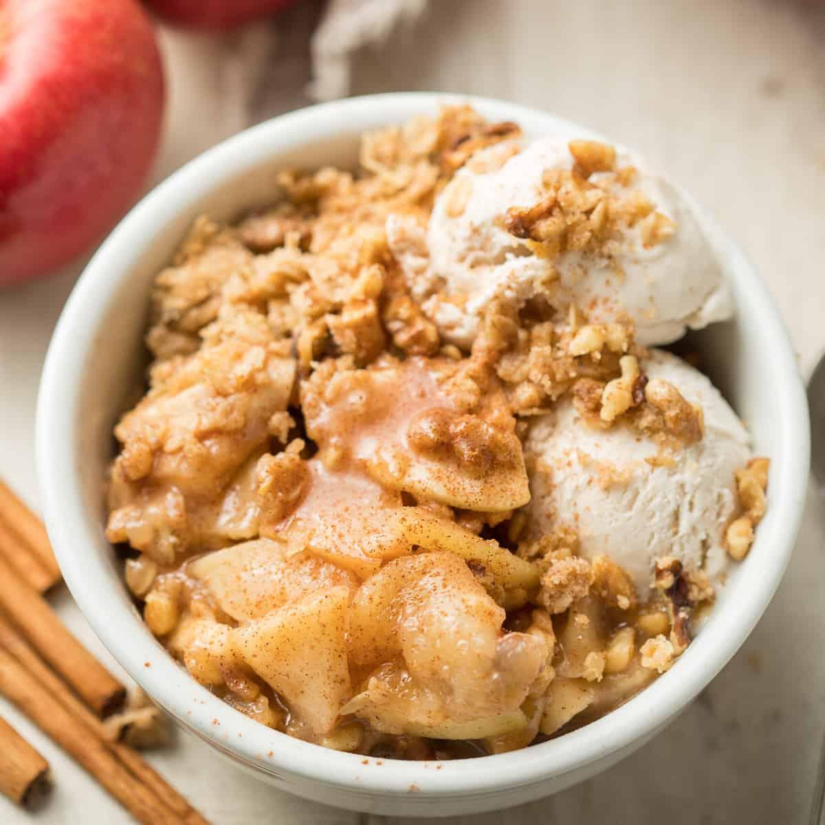 Bowl of Vegan Apple Crisp with Two Scoops of Ice Cream