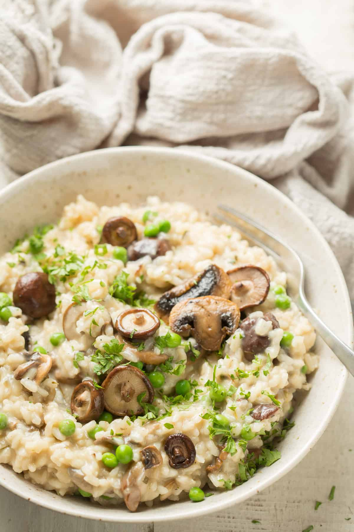 Bowl of Vegan Mushroom Risotto with fork.