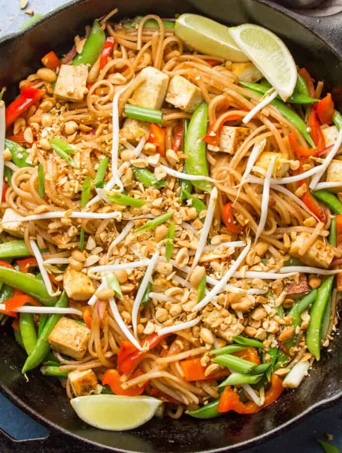 Skillet of Vegan Pad Thai with Lime Slices