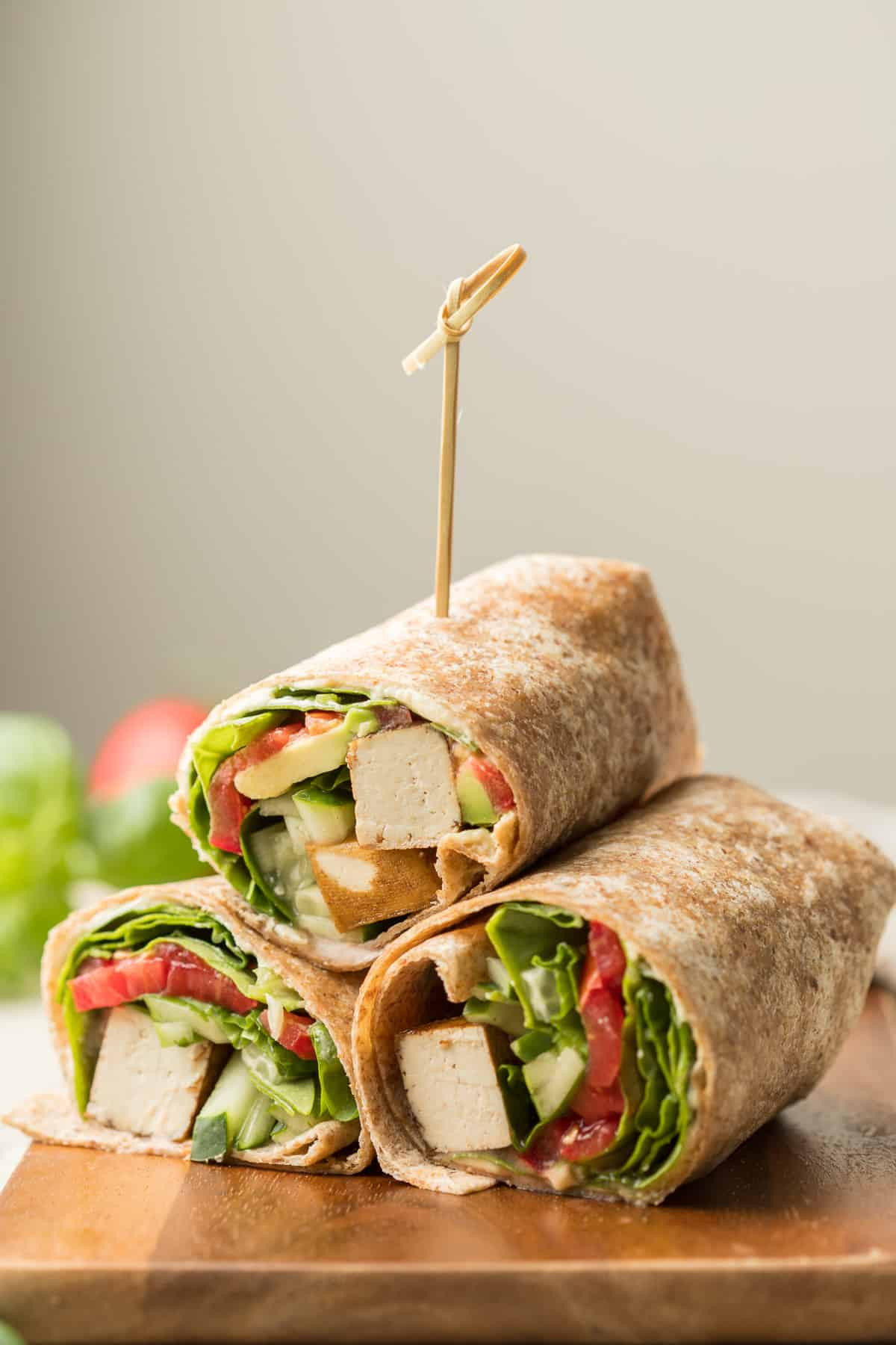 Three Vegan Wrap Halves Stacked in a Triangle