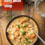 """Bowl of Navy Bean Soup with Text Overlay Reading """"Smoky Navy Bean Soup"""""""