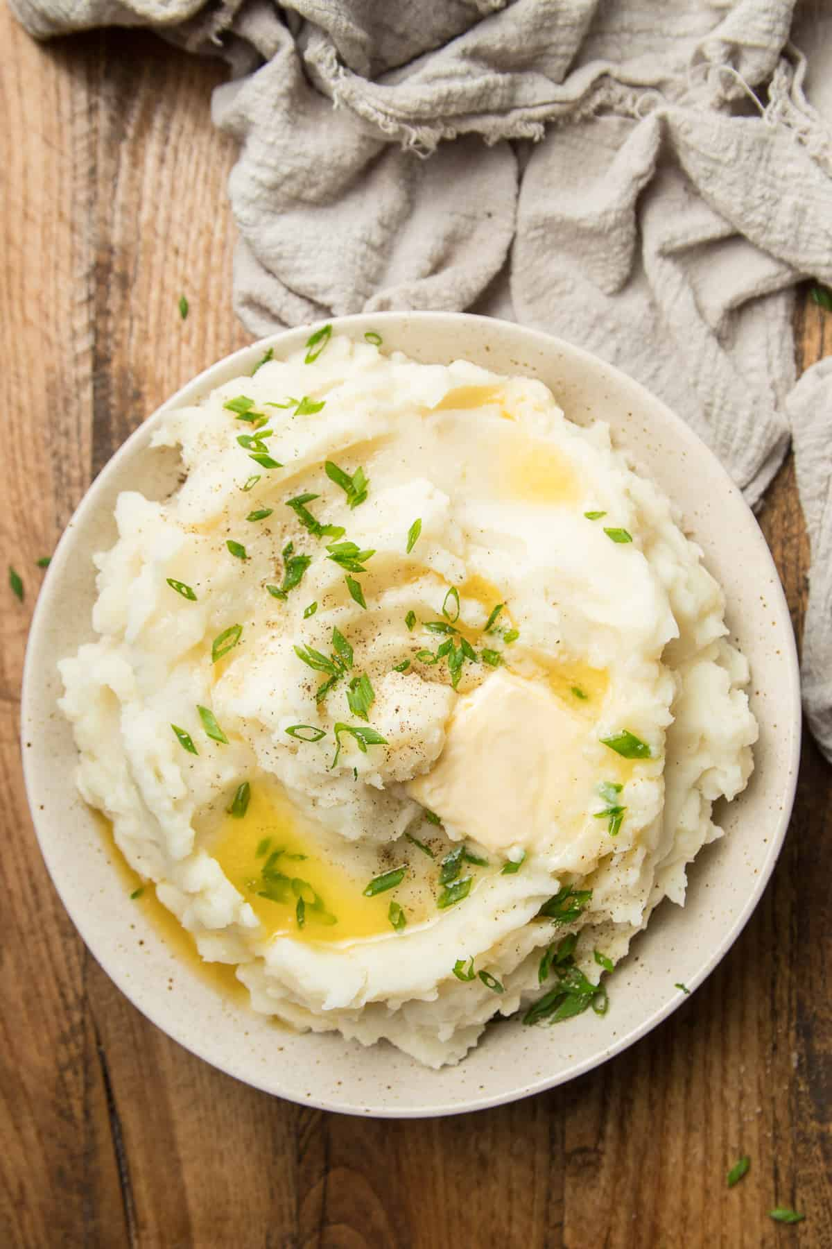 Bowl of Vegan Mashed Potatoes on a Wooden Surface