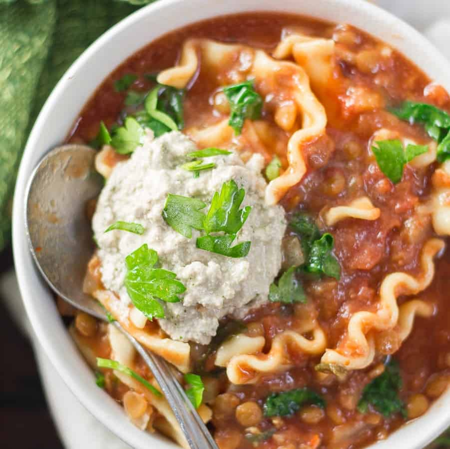 Close up of a bowl of Vegan Lasagna Soup topped with tofu ricotta.