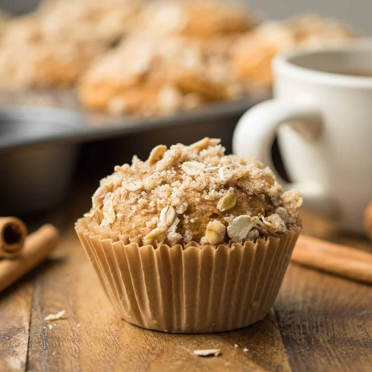Close up of a Vegan Pumpkin Muffin with streusel on top.
